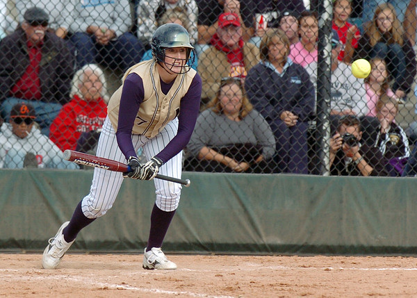 Legacy's Molly Madsen makes a bunt during the state 5A softball championship game against Ralston Valley, Saturday, at the Aurora Sports Park. <br /> October 24, 2009<br /> Staff photo/David R. Jennings