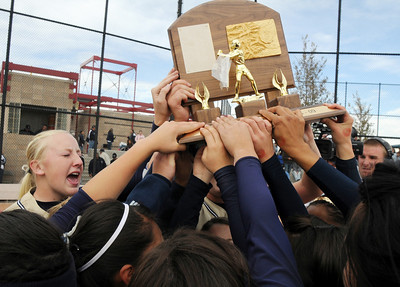 The Lightning team touches the trophy after winning their third consecutive state 5A softball championship  by  defeating Ralston Valley 1-0 in 8 innings Saturday at the Aurora Sports Park.   October 24, 2009 Staff photo/David R. Jennings