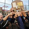 The Lightning team touches the trophy after winning their third consecutive state 5A softball championship  by  defeating Ralston Valley 1-0 in 8 innings Saturday at the Aurora Sports Park. <br /> <br /> October 24, 2009<br /> Staff photo/David R. Jennings
