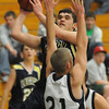 Jade Roberts, above center,  Legacy, shoots for two over Kyle Roll, Standley Lake during Wednesday's game at Standley Lake.<br /> <br /> December 16, 2009<br /> Staff photo/David R. Jennings