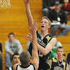 Mike Lehnerz, right,  Legacy, shoots over Kyle Roll, Standley Lake during Wednesday's game at Standley Lake.<br /> <br /> December 16, 2009<br /> Staff photo/David R. Jennings
