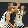Tim Schmuhl, center,  Legacy, passes the ball between Standley Lake's Kyle Roll, left, and Tony Sykes Jr. during Wednesday's game at Standley Lake.<br /> <br /> December 16, 2009<br /> Staff photo/David R. Jennings