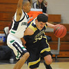 Jade Roberts, right, Legacy, drives the down court past Troy Sykes Jr., Standley Lake during Wednesday's game at Standley Lake.<br /> <br /> December 16, 2009<br /> Staff photo/David R. Jennings