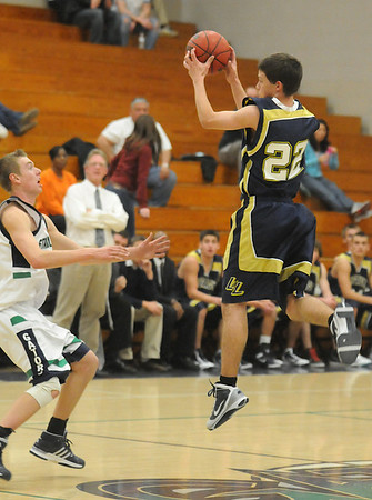 Billy Hayward, right,  Legacy , catches a high pass over Cole Harding, Standley Lake during Wednesday's game at Standley Lake.<br /> <br /> December 16, 2009<br /> Staff photo/David R. Jennings
