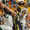 Brett Gioia, center,  Legacy, fights for the ball with Cole Harding, Standley Lake during Wednesday's game at Standley Lake.<br /> <br /> December 16, 2009<br /> Staff photo/David R. Jennings