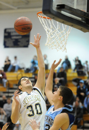 Legacy's Jade Roberts goes to the basket against  Mountain Range's Mitch Castillo during Tuesday's game at Legacy.<br /> <br /> <br /> February 9, 2010<br /> Staff photo/David R. Jennings
