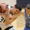 Legacy's Jade Roberts fights for the ball with Mountain Range's Edgar Crockett during Tuesday's game at Legacy.<br /> <br /> <br /> February 9, 2010<br /> Staff photo/David R. Jennings