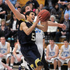 Legacy's Marcus Riddick goes to the basket against Ralston Valley's Tanner Svejcar during Tuesday's game at Ralston Valley.<br /> February 23, 2011<br /> staff photo/David R. Jennings
