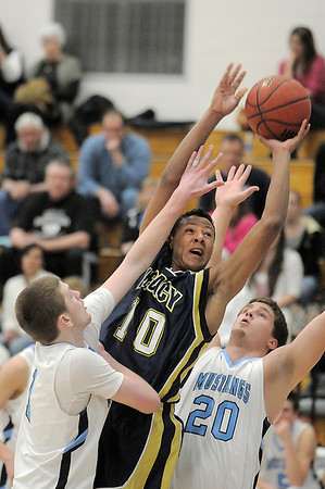 Legacy's Phillip Kee goes to the basket against Ralston Valley's Chase Duben and Tanner Svejcar during Tuesday's game at Ralston Valley.<br /> February 23, 2011<br /> staff photo/David R. Jennings