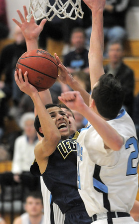 Legacy's Marcus Riccick tries to get to the basket against Ralston Valley's Tanner Svejcar during Tuesday's game at Ralston Valley.<br /> February 23, 2011<br /> staff photo/David R. Jennings