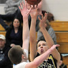 Legacy's Billy Hayward shoots the ball past Ralston Valley's Chase Dubin during Tuesday's game at Ralston Valley.<br /> February 23, 2011<br /> staff photo/David R. Jennings