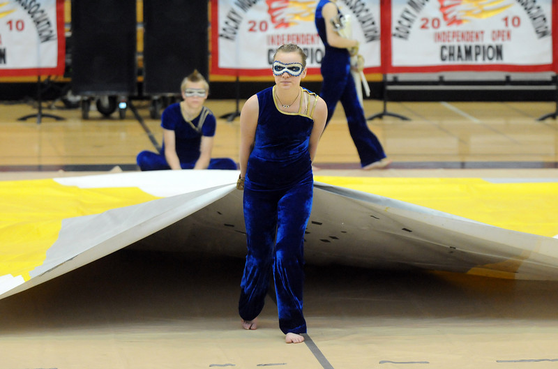 Danyelle Gorny helps pull the mat out before  Legacy's Color Guard performance at the Rocky Mountain Color Guard Association state competition at Legacy  on Saturday.<br /> <br /> March 27, 2010<br /> Staff photo/David R. Jennings