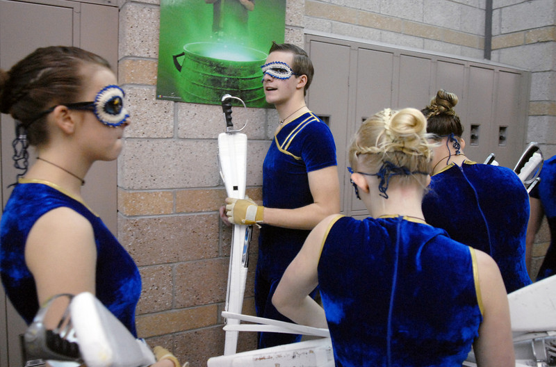 Jeffrey Hargis, center, makes sure Legacy's Color Guard is ready before their performance at the Rocky Mountain Color Guard Association state competition at Legacy  on Saturday.<br /> <br /> March 27, 2010<br /> Staff photo/David R. Jennings