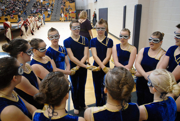 The Legacy Color Guard hold hands before their performance at the Rocky Mountain Color Guard Association state competition at Legacy  on Saturday.<br /> <br /> March 27, 2010<br /> Staff photo/David R. Jennings