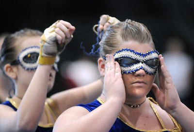 Kourtney Bernhardt, 18, right, has her mask adjusted by Alex Trujillo, 15, before Legacy's Color Guard performance at the Rocky Mountain Color Guard Association state competition at Legacy  on Saturday.  March 27, 2010 Staff photo/David R. Jennings