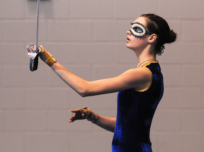 Oriana Meldrum, 14, warms-up catching her sword before Legacy's Color Guard performance at the Rocky Mountain Color Guard Association state competition at Legacy  on Saturday.  March 27, 2010 Staff photo/David R. Jennings
