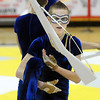 Weston Schutt executes rifle maneuvers during Legacy's Color Guard performance at the Rocky Mountain Color Guard Association state competition at Legacy  on Saturday.<br /> <br /> March 27, 2010<br /> Staff photo/David R. Jennings