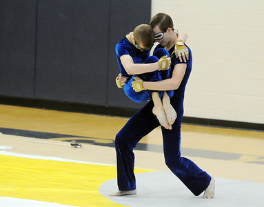 Jeffrey Hargis carries Weston Schutt during Legacy's Color Guard performance at the Rocky Mountain Color Guard Association state competition at Legacy  on Saturday.  March 27, 2010 Staff photo/David R. Jennings