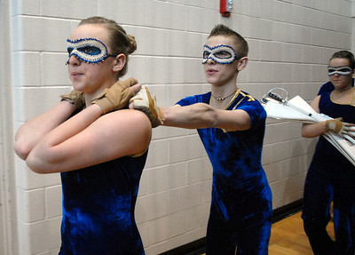 WEston Schutt, 17, right holds on to Danyelle Gorny, 16, as the Legacy's Color Guard walks to the gym for their performance at the Rocky Mountain Color Guard Association state competition at Legacy on Saturday.  March 27, 2010 Staff photo/David R. Jennings