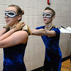 WEston Schutt, 17, right holds on to Danyelle Gorny, 16, as the Legacy's Color Guard walks to the gym for their performance at the Rocky Mountain Color Guard Association state competition at Legacy on Saturday.<br /> <br /> March 27, 2010<br /> Staff photo/David R. Jennings