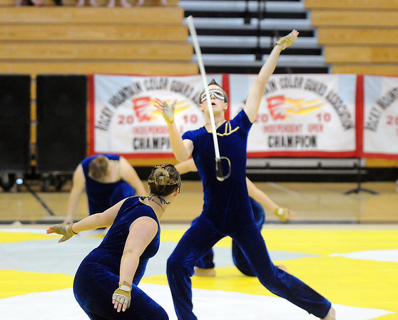 Jeffrey Hargis catches a sword while dancing during Legacy's Color Guard performance at the Rocky Mountain Color Guard Association state competition at Legacy  on Saturday.<br /> <br /> March 27, 2010<br /> Staff photo/David R. Jennings