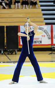 Jeffrey Hargis performs sword maneuvers while dancing  during Legacy's Color Guard performance at the Rocky Mountain Color Guard Association state competition at Legacy  on Saturday.  March 27, 2010 Staff photo/David R. Jennings