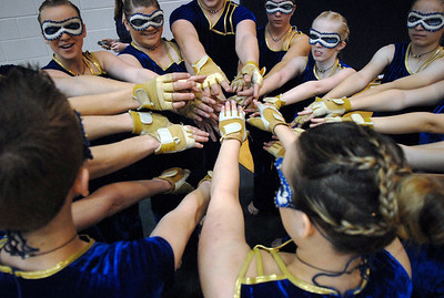 The Legacy Color Guard touch hands before their performance at the Rocky Mountain Color Guard Association state competition at Legacy  on Saturday.  March 27, 2010 Staff photo/David R. Jennings