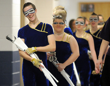 Jeffrey Hargis,17, leads Legacy's Color Guard to the warm-up room before their performance at the Rocky Mountain Color Guard Association state competition at Legacy  on Saturday.  March 27, 2010 Staff photo/David R. Jennings