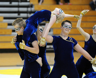 Jeff Martin carries  Beverly Houston on his shoulders during Legacy's Color Guard performance at the Rocky Mountain Color Guard Association state competition at Legacy  on Saturday.   March 27, 2010 Staff photo/David R. Jennings