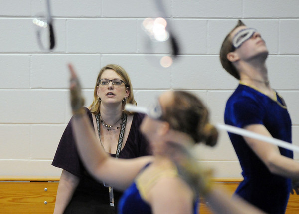 Instructor Amy Lueb watches  Legacy's Color Guard warm-up before their performance at the Rocky Mountain Color Guard Association state competition at Legacy  on Saturday.<br /> <br /> March 27, 2010<br /> Staff photo/David R. Jennings