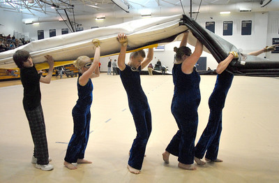 The Legacy Color Guard carries the mat off after their performance at the Rocky Mountain Color Guard Association state competition at Legacy  on Saturday.  March 27, 2010 Staff photo/David R. Jennings