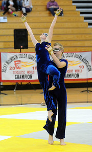 Jeff Martin lifts Beverly Houston during Legacy's Color Guard performance at the Rocky Mountain Color Guard Association state competition at Legacy  on Saturday.  March 27, 2010 Staff photo/David R. Jennings