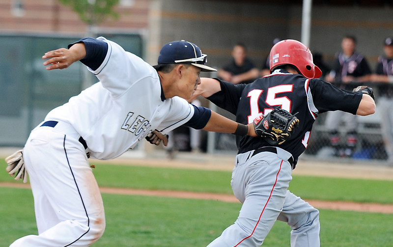 Legacy's Daniel Lee tags out  Fairview's Kyle Hernden stuck between third and home bases during Thursday's game at Legacy.<br /> <br /> April 26, 2012 <br /> staff photo/ David R. Jennings