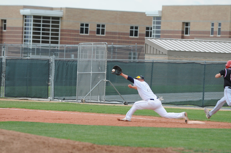 Legacy's Drew Wells reachs to catch the ball at first base forcing out  Fairview during Thursday's game at Legacy.<br /> <br /> April 26, 2012 <br /> staff photo/ David R. Jennings