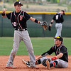 Fairview's Cameron Frazier sits while Johnny Feauto throws the ball after Legacy safely made it to second base during Thursday's game at Legacy.<br /> <br /> April 26, 2012 <br /> staff photo/ David R. Jennings