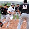 Fairview's Cameron Frazier tags out Legacy's Jacob Camerlo who was caught between second and third bases during Thursday's game at Legacy.<br /> <br /> April 26, 2012 <br /> staff photo/ David R. Jennings