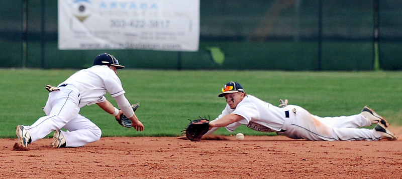 Legacy's  Dillon Bollig, left, and Dylan Farrell nearly collide while diving for a ball hit by Fairview during Thursday's game at Legacy.<br /> <br /> April 26, 2012 <br /> staff photo/ David R. Jennings