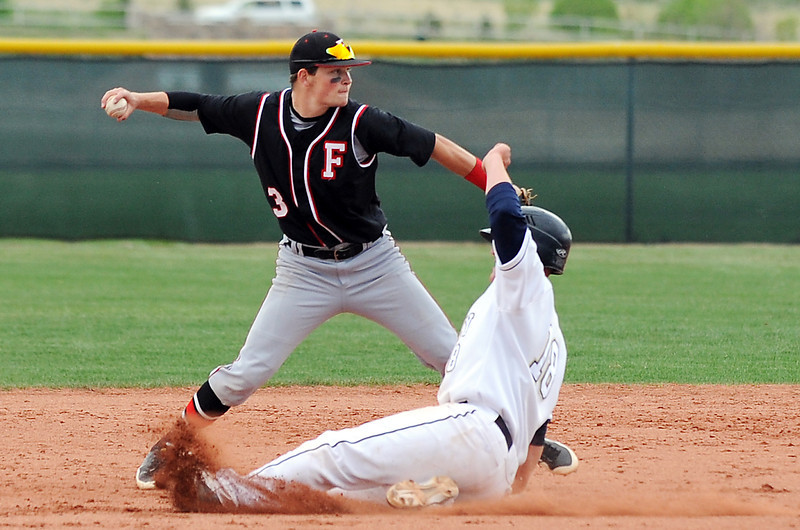 Fairview's Cameron Frazier throws to first base aafter forcing out  Legacy's Drew Wells during Thursday's game at Legacy.<br /> <br /> April 26, 2012 <br /> staff photo/ David R. Jennings
