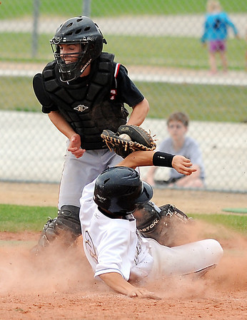 Legacy's Alex Wagner slides safely to home past Fairview's catcher, Cannon Casey during Thursday's game at Legacy.<br /> <br /> April 26, 2012 <br /> staff photo/ David R. Jennings