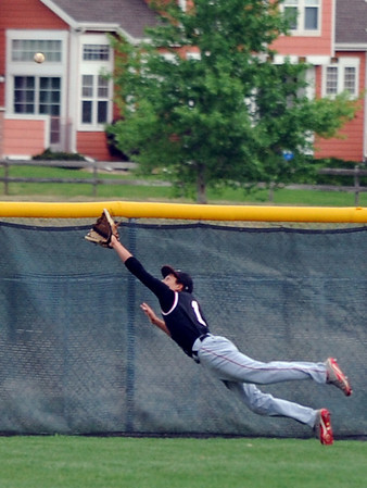 Fairview's Tim Ryan dives for the ball hit to the outfield by Legacy during Thursday's game at Legacy.<br /> <br /> April 26, 2012 <br /> staff photo/ David R. Jennings