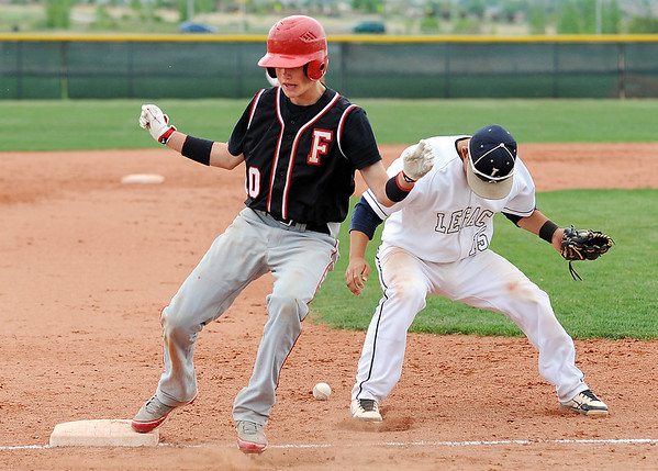 Fairview's Johnny Feauto makes it safely to third after  Legacy's Daniel Lee dropped the ball during Thursday's game at Legacy.<br /> <br /> April 26, 2012 <br /> staff photo/ David R. Jennings