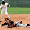 Legacy's Alex Wagner runs to third base as Fairview's Cameron Frazier lays on the ground after missing the ball during Thursday's game at Legacy.<br /> <br /> April 26, 2012 <br /> staff photo/ David R. Jennings