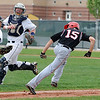 Legacy's Daniel Lee, left and Ty Overboe chase down  Fairview's Kyle Hernden stuck between third and home bases during Thursday's game at Legacy.<br /> <br /> April 26, 2012 <br /> staff photo/ David R. Jennings