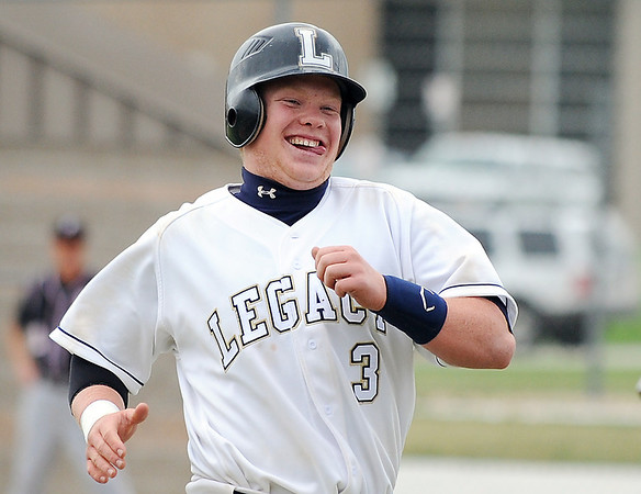 Legacy's Ty Overboe is all smiles after making a hit against Fairview during Thursday's game at Legacy.<br /> <br /> April 26, 2012 <br /> staff photo/ David R. Jennings