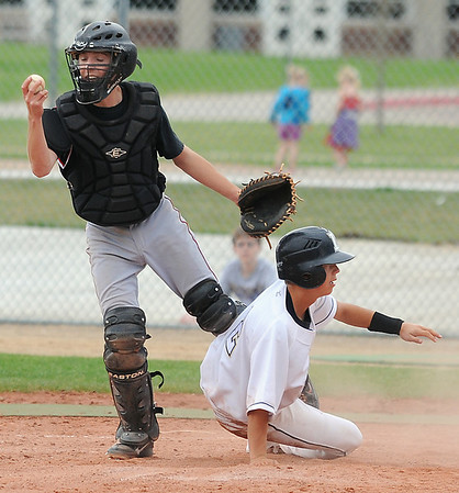 Legacy's Alex Wagner slides safely to home past Fairview's catcher Cannon Casey during Thursday's game at Legacy.<br /> <br /> <br /> April 26, 2012 <br /> staff photo/ David R. Jennings