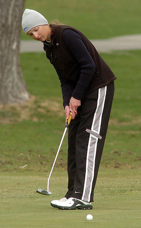 Sarah Hankins, Legacy, makes a putt on the third green during play at Coal Creek Golf Course on Wednesday. <br /> <br /> April 20, 2011<br /> staff photo/David R. Jennings