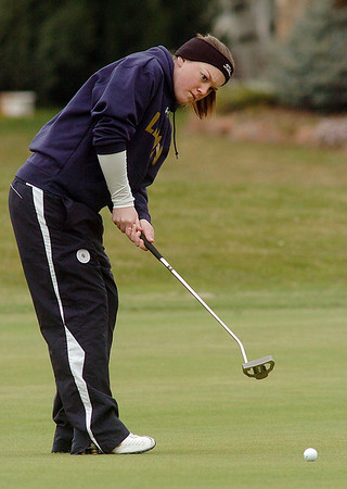 Taylor Evans, Legacy, putts on the first hole green during play at Coal Creek Golf Course on Wednesday. <br /> <br /> April 20, 2011<br /> staff photo/David R. Jennings