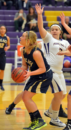 Legacy's Bree Paulson goes to the basket past Boulder's Vivi Gregorich during Thursday's game at Boulder High.<br /> January 10, 2013<br /> staff photo/ David R. Jennings