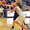 Legacy's Caitlyn Smith pass the ahead of  Boulder's Courtney Van Bussum during Thursday's game at Boulder High.<br /> January 10, 2013<br /> staff photo/ David R. Jennings