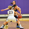 Legacy's Emiley Lopez looses the ball while being boxed in by Boulder's Lena Jaycox and Jacque Szarmach  during Thursday's game at Boulder High.<br /> January 10, 2013<br /> staff photo/ David R. Jennings